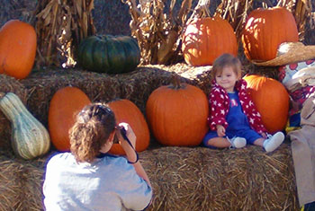 Our pumpkin display at Peckham's Pumpkin Patch is a great opportunity for photos. Stop by Pleasant Ridge Farm this fall for family fun and pumpkins!